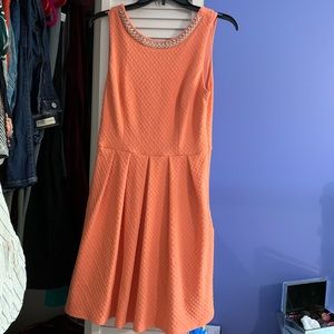 Adorable orange dress with jewels and bow